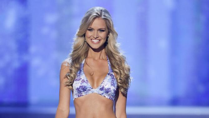 Renae Ayris, Miss Australia, walks the stage during the swimsuit portion of the Miss Universe competition, Wednesday, Dec. 19, 2012, in Las Vegas. (AP Photo/Julie Jacobson)
