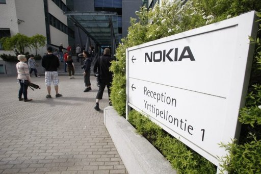 <p>Nokia employees arrive for a briefing on June 14 at company headquarters in Espoo, Finland. Nokia chief executive Stephen Elop admitted on Thursday that his company had failed to foresee rapid changes in the mobile phone industry and this was partly behind the firm's problems.</p>