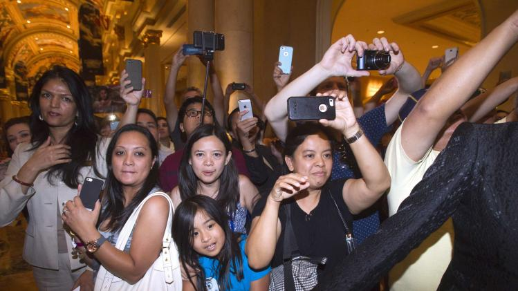 Fans of Manny Pacquiao try to get his photo as he arrives at the Venetian Las Vegas Resort in Nevada