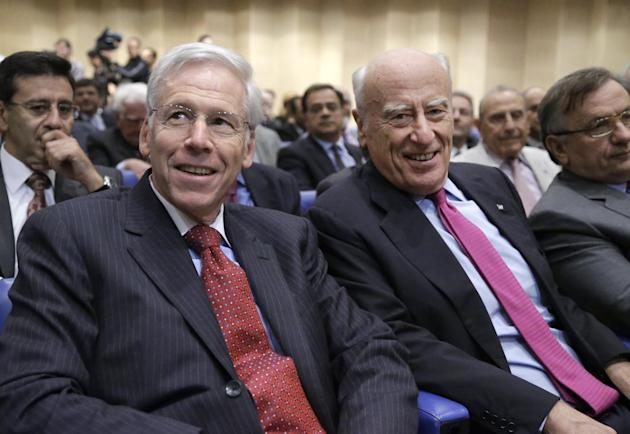 Charles Dallara, head of Greece's bondholders lobbying group, the Institute of International Finance, left, sits with Greece's Alpha Bank Chairman Yiannis Kostopoulos, before his speech at the Nationa