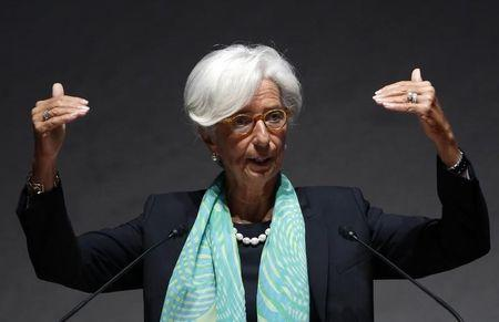 IMF Managing Director Lagarde gestures as she gives a speech during World Assembly for Women in Tokyo