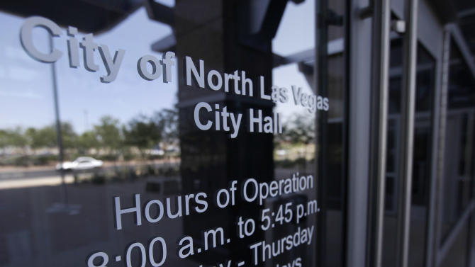 Office hours are posted on the front door of the North Las Vegas City Hall building, Thursday, June 21, 2012, in North Las Vegas, Nev. Despite its suburban trimmings, this blue-collar, family-oriented city outside Las Vegas is officially a disaster area. Faced with an unrelenting tide of foreclosures and bankruptcies, Nevada has the highest unemployment rate in the nation. North Las Vegas is among its hardest-hit cities, with the state threatening to take it over every few months. (AP Photo/Julie Jacobson)