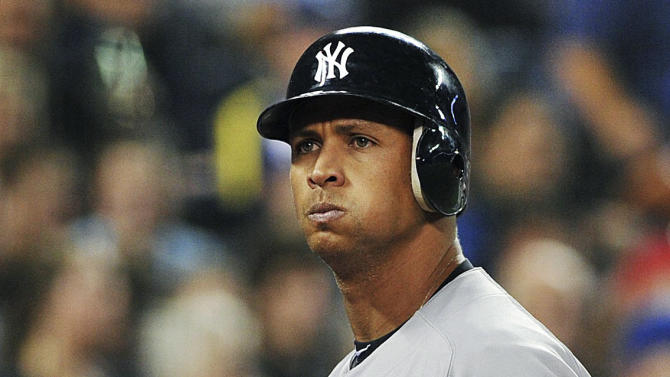 New York Yankees' Alex Rodriguez walks off field after striking out against the Toronto Blue Jays during the fourth inning of a baseball game in Toronto, Thursday, Sept. 27, 2012. (AP Photo/The Canadian Press, Aaron Vincent Elkaim)