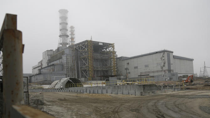 The damaged reactor at the Chernobyl nuclear power plant in Chernobyl, Ukraine Tuesday, Nov. 27, 2012. Workers on Tuesday, Nov. 27, 2012 raised the first section of a colossal arch-shaped structure that is eventually to cover the exploded reactor at the Chernobyl nuclear power station. Project officials on Tuesday hailed the raising as a significant step in a complex effort to liquidate the consequences of the world's worst nuclear accident, in 1986. (AP Photo/Efrem Lukatsky)