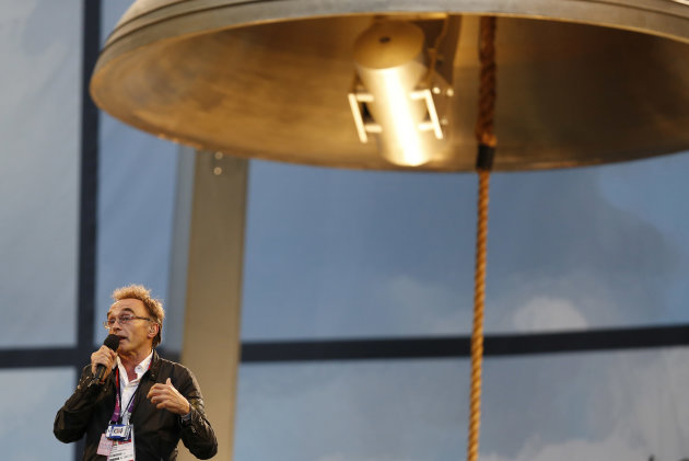 Opening Ceremony artistic director Danny Boyle speaks next to the Olympic Bell ahead of the Opening Ceremony at the 2012 Summer Olympics, Friday, July 27, 2012, in London. (AP Photo/Matt Dunham)