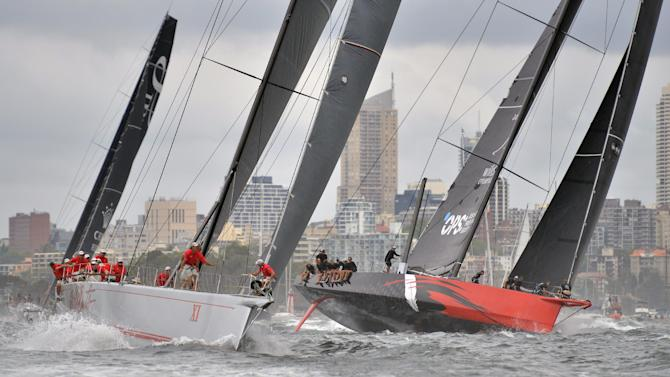 Supermaxi yachts Australian Wild Oats (L) and US Comanche are shown in Sydney Harbour, December 9, 2014