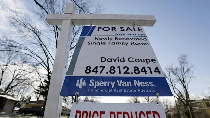 "In this Saturday, Jan. 5, 2013, photo, a ""for sale"" sign is seen outside a home in Glenview, Ill.  Average U.S. rates on fixed mortgages rose this week but remained close to record lows. Cheap mortgages have made home buying more affordable and have helped drive a housing recovery.  (AP Photo/Nam Y. Huh)"