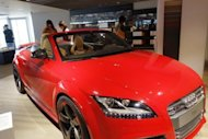 People visit a car showroom in Beijing on May 13, 2013. Growth in China's auto sales slowed in May from a double-digit rise in April, an industry group said, as new data fuelled concerns that the world's second-biggest economy is faltering