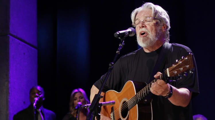 "FILE - This Oct. 21, 2012 file photo shows Bob Seger performing at the Country Music Hall of Fame Inductions in Nashville, Tenn. Former coma patient Evie Branan attended Seger's concert Thursday, April 11, 2013, at The Palace of Auburn Hills in Michigan. Branan, of Flint Township, emerged from a five-year semi-coma  on May 7, 2011.  Her first words were, ""I want to go to a Bob Seger concert.""  She also met Seger and his family, talked with crew and band members and received VIP treatment. (Photo by Wade Payne/Invision/AP, file)"