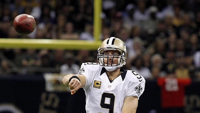 New Orleans Saints quarterback Drew Brees (9) passes in the first half of an NFL football game against the Kansas City Chiefsn in New Orleans, Sunday, Sept. 23, 2012. (AP Photo/Jonathan Bachman)
