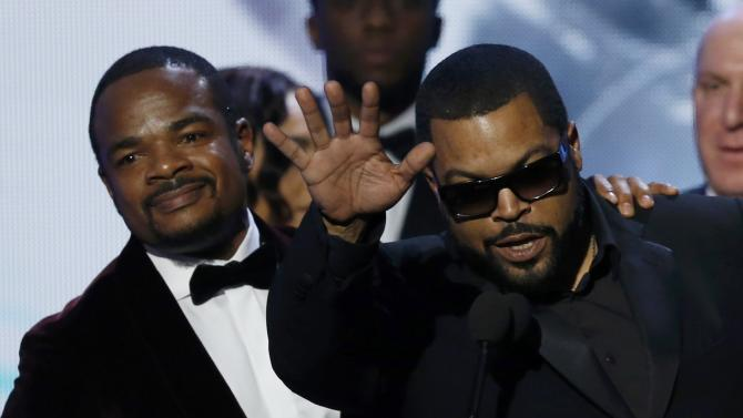"Producer Ice Cube accepts the award for Outstand Motion Picture for ""Straight Outta Compton"" with director F. Gary Gray at the 47th NAACP Image Awards in Pasadena"