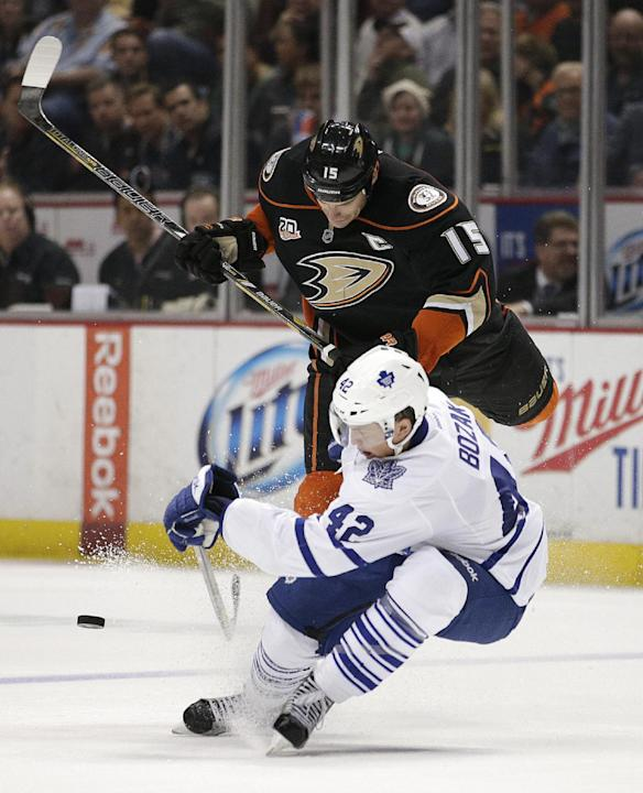 Anaheim Ducks' Ryan Getzlaf, top, and Toronto Maple Leafs' Tyler Bozak fight for the puck during the second period of an NHL hockey game on Monday, March 10, 2014, in Anaheim, Calif