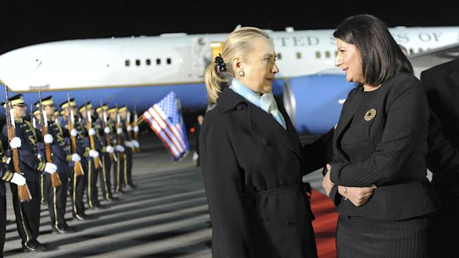 Kosovo President Atifete Jahjaga, right, welcomes US Secretary of State Hillary Rodham Clinton, upon her arrival in Kosovo capital Pristina on Tuesday, Oct. 30, 2012. Clinton and European Union foreign policy chief Catherine Ashton are on a joint diplomatic tour of the Balkans, urging rival ethnic groups and governments in Bosnia, Serbia and Kosovo to settle their differences. (AP Photo)
