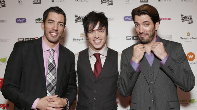 Jonathan Silver Scott,  J.D. Scott and Drew Scott attend the Producers Ball 2012 at the Shangri-La Toronto on Wednesday Sept. 5, 2012, in Toronto, Canada. (Photo by Todd Williamson/Invision for the Producers Ball/AP Images)