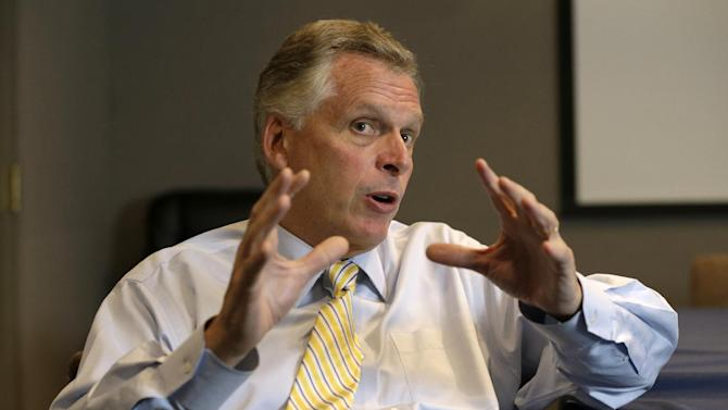 This photo taken Tuesday, Oct. 15, 2013, shows Virginia Democratic gubernatorial candidate Terry McAuliffe gesturing during an interview in Richmond, Va. McAuliffe's campaign strategy in his second attempt to become Virginia's governor comes down to this: dramatically outspend his opponent, take advantage of outside factors _ and curtail his outspoken tendencies. If successful, McAuliffe will break a long streak in this state's history: during the last nine governor's races, the party in White House lost. McAuliffe faces Republican Ken Cuccinelli in the November election. (AP Photo/Steve Helber)