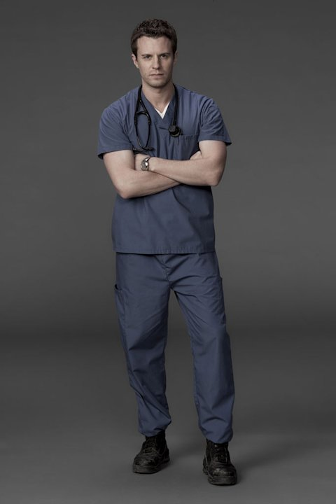 "Luke Mably stars as Dr. Simon Hill in ""Combat Hospital."""