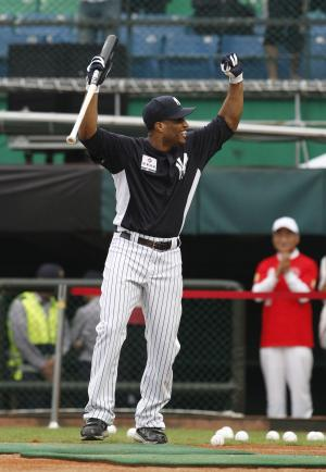 Robinson Cano of the New York Yankees cheers back with fans during batting practice for the Taiwan All Star Series in Xinzhuang, Taiwan, Monday, Oct. 31, 2011. The major leaguers will play five baseball games against Taiwan's team from Nov. 1-6. (AP Photo/Wally Santana)