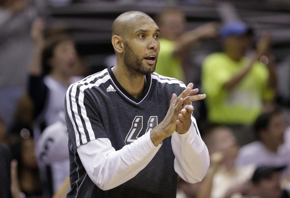 San Antonio Spurs' Tim Duncan cheers his teammates during the second half in Game 1 of a Western Conference Finals NBA basketball playoff series against the Memphis Grizzlies, Sunday, May 19, 2013, in San Antonio. San Antonio won 105-83. (AP Photo/Eric Gay)