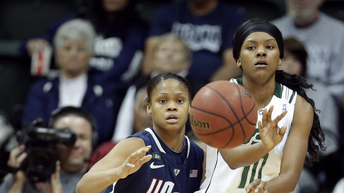 South Florida guard Courtney Williams (10) sends a pass to a teammate as Connecticut guard Moriah Jefferson (4) defends during the second half of an NCAA women's college basketball game Saturday, March 2, 2013, in Tampa, Fla. Connecticut won the game 85-51. (AP Photo/Chris O'Meara)