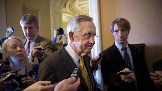 """Senate Majority Leader Harry Reid, D-Nev., walks to a closed-door meeting with fellow Democrats as he and Senate Minority Leader Mitch McConnell, R-Ky., work to negotiate a legislative path to avoid the so-called """"fiscal cliff,"""" at the Capitol in Washington, Sunday, Dec. 30, 2012. Senate and House leaders are rushing to assemble a last-ditch agreement to stave off middle-class tax increases and possibly delay steep spending cuts in an urgent attempt to find common ground after weeks of gridlock. (AP Photo/J. Scott Applewhite)"""