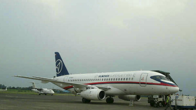 In this Tuesday, May 8, 2012 photo, a Russian-made Sukhoi Superjet-100  is parked on the tarmac at Halim Perdanakusuma Airport in Jakarta, Indonesia. The plane carrying 46 people lost contact with air controllers while flying over mountains during a demonstration flight Wednesday in western Indonesia, officials said. (AP Photo)