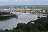 "Aerial shots of the Palangkaraya river in Palangkaraya, capital of Kalimantan province in Indonesia's Borneo island. Broadcasting over the Palangkaraya area, Radio Kalaweit's audience varies ""from 10,000-15,000 listeners a day"" and commercial advertising ensures it is self-financing"