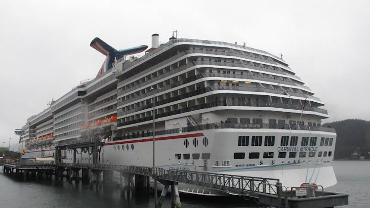 FILE - This May 2, 2013 file photo shows The Carnival Miracle docked in Juneau, Alaska. The nation's largest cruise ship company will adopt technology from power plants and automobiles to reduce air pollution from the massive diesel engines powering its ships. In a tentative agreement reached Thursday with the Environmental Protection Agency (EPA), Carnival Corp. will deploy scrubbers to reduce sulfur dioxide and filters to trap soot on as many as 32 ships over the next three years. At port, ships will plug into the electrical grid, rather than idle, to reduce pollution. (AP Photo/Becky Bohrer, File)