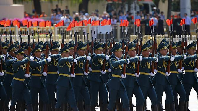Kyrgyzstan's soldiers march during the military parade marking the 70th anniversary of the end of World War Two, in Beijing
