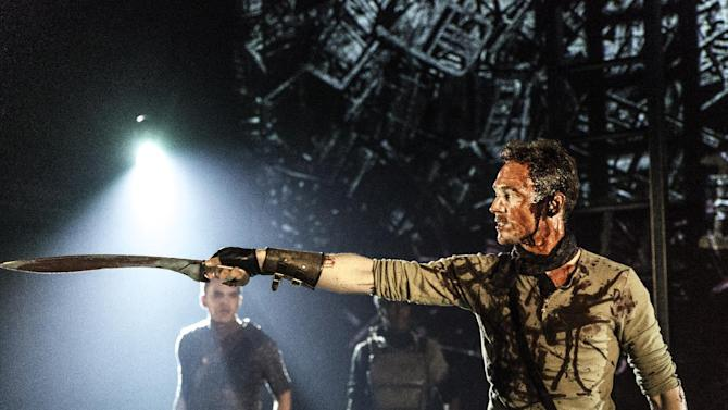 """In this photo released by The Donmar Warehouse on Wednesday, Dec. 18, 2013, actor Tom Hiddleston stars as Coriolanus in William Shakespeare's play, being performed at The Donmar warehouse in London. The British actor has returned to his classical stage roots with an acclaimed starring role in William Shakespeare's """"Coriolanus."""" """"Shakespeare led me to superheroes,"""" Hiddleston told Wednesday's edition of the Evening Standard newspaper, as critics raved about his performance in the Bard's blood-soaked tragedy at the 250-seat Donmar Warehouse. (AP Photo / Johan Persson)"""