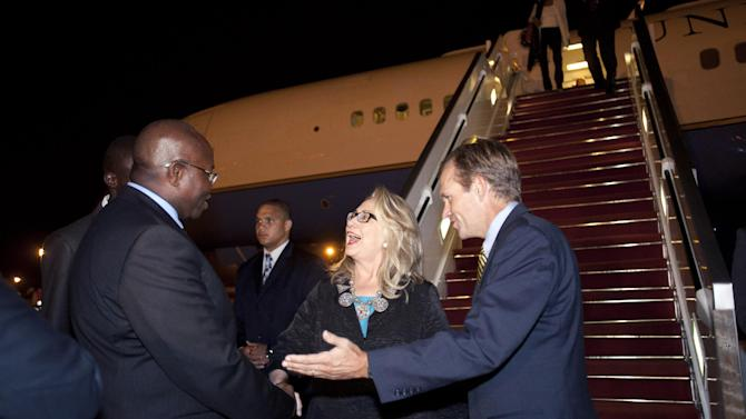 U.S. Ambassador to Senegal Lewis Lukens, right, and U.S. Secretary of State Hillary Rodham Clinton talks as she arrives in Dakar, Senegal, on Tuesday, July 31, 2012. (AP Photo/Jacquelyn Martin, Pool)