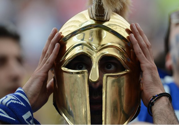TOPSHOTS A Fan Of Greece's National Football Team Weraing A Helmet Reacts Prior To The Euro 2012 Football Match Poland AFP/Getty Images