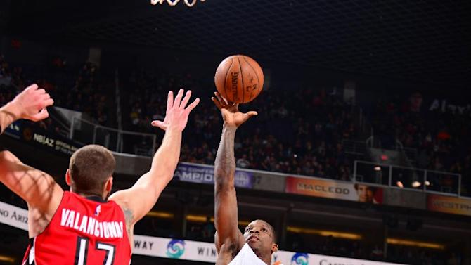Suns guard trio leads 125-109 rout of road-weary Raptors