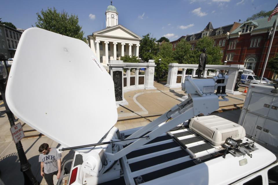 Television satellite trucks line South Allegheny Street in front of the Centre County Courthouse in Bellefonte, Pa., Sunday, June 10, 2012, in preparation for opening statements in the child sexual abuse trial of former Penn State Football assistant football coach Jerry Sandusky on Monday morning. (AP Photo/Gene J. Puskar)