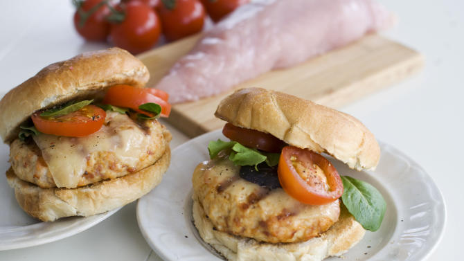 In this undated image, chopped turkey tenderloin makes a lean and delicious burger, especially when spiked with smoked paprika and prosciutto, and served with manchego cheese in Concord, N.H. (AP Photo/Matthew Mead)