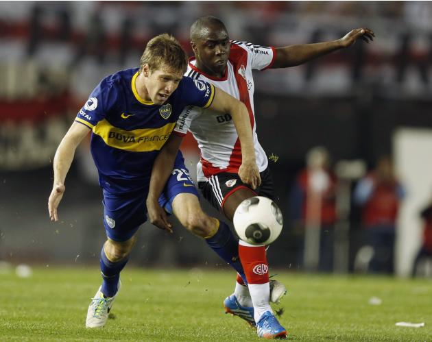 Boca Juniors' Riano is challenged by River Plate's Balanta during their Argentine Championship First Division soccer match in Buenos Aires