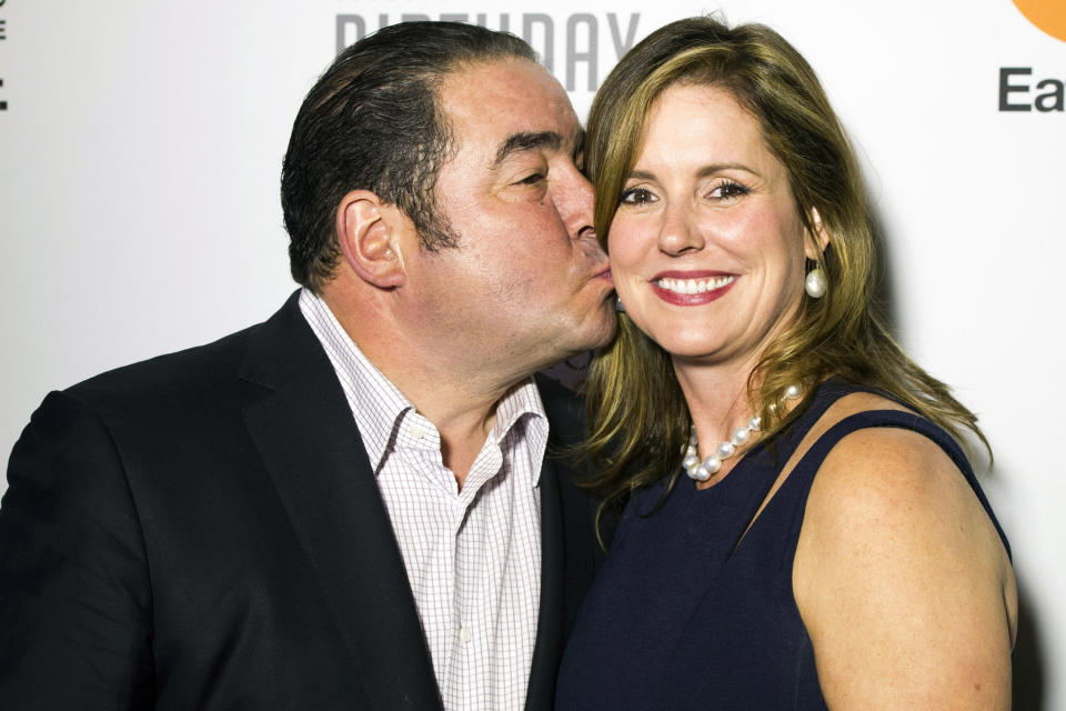 Emeril Lagasse, left, and Alden Lovelace attend the Food Network's 20th birthday party on Thursday, Oct. 17, 2013, in New York. (Photo by Charles Sykes/Invision/AP)