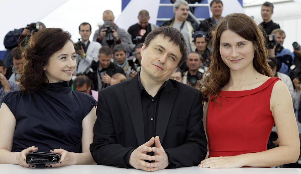 Director Director Christian Mungiu, center, poses with actors Cosmina Stratan, left, and Christina Flutur during a photo call for Beyond the Hills at the 65th international film festival, in Cannes, southern France, Saturday, May 19, 2012. (AP Photo/Francois Mori)