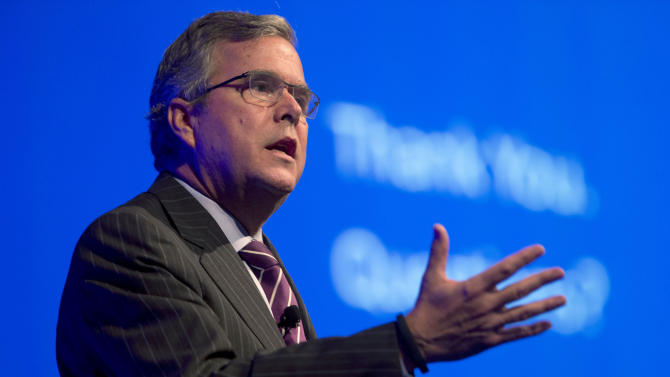 FILE - This Jan. 29, 2014 file photo shows former Florida Gov. Jeb Bush speaking in Hollywood, Fla. Bush said Thursday the partisan divide isn't as wide when it comes to improving the nation's higher education system as it is in many other areas. Hillary Rodham Clinton, who like Bush is often mentioned as a potential 2016 president candidate, accepted Bush's invitation to appear at a conference he is co-hosting on global higher education issues. It begins Monday in Irving, Texas. (AP Photo/Wilfredo Lee, File)