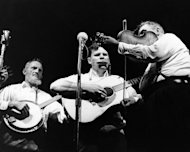 FILE - In this July 24, 1963 file photo, Doc Watson, center, performs with the Watson Family on the opening night of the Newport Folk Festival in Newport, R.I. Doc Watson, the Grammy-award winning folk musician whose lightning-fast style of flatpicking influenced guitarists around the world for more than a half-century, died Tuesday, May 29, 2012 at a hospital in Winston-Salem, according to a hospital spokeswoman and his management company. He was 89. (AP File Photo)