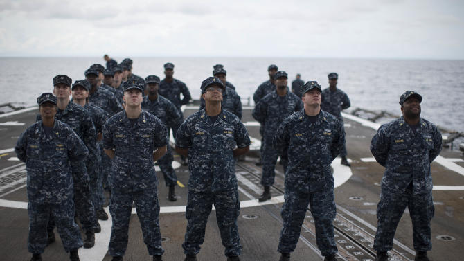ADVANCED FOR USE SUNDAY FEB. 3 AND THEREAFTER In this Monday, Oct. 15, 2012 photo, sailors pose for a photo on the flight deck of the USS Underwood while patrolling in international waters near Panama. In the most expensive initiative in Latin America since the Cold War, the U.S. has militarized the battle against drug traffickers, spending more than $20 billion in the past decade.  U.S. Army troops, Air Force pilots and Navy ships outfitted with Coast Guard counternarcotics teams are routinely deployed to chase, track and capture drug smugglers. (AP Photo/Dario Lopez-Mills)