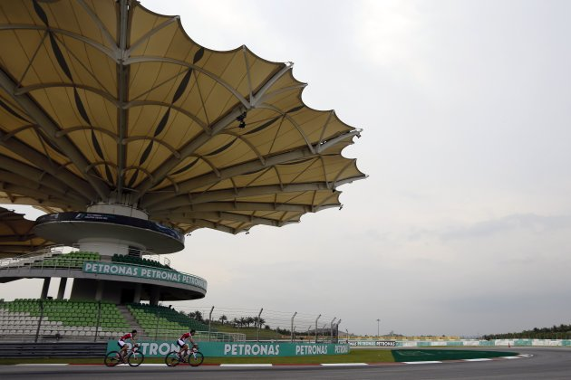 Ferrari F1 driver Alonso rides his bicycle around the Sepang International Circuit, ahead of the Malaysia F1 Grand Prix