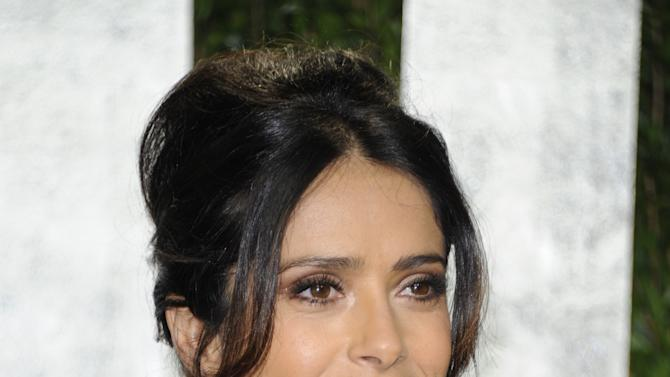 FILE - In this Feb. 26, 2012 file photo, Mexican actress Salma Hayek arrives at the Vanity Fair Oscar party in West Hollywood, Calif. Hayek attended a fundraiser for President Barack Obama on Thursday, May 10, 2012, hosted by actor-activist George Clooney at his Studio City, Calif., home. (AP Photo/Evan Agostini, file)