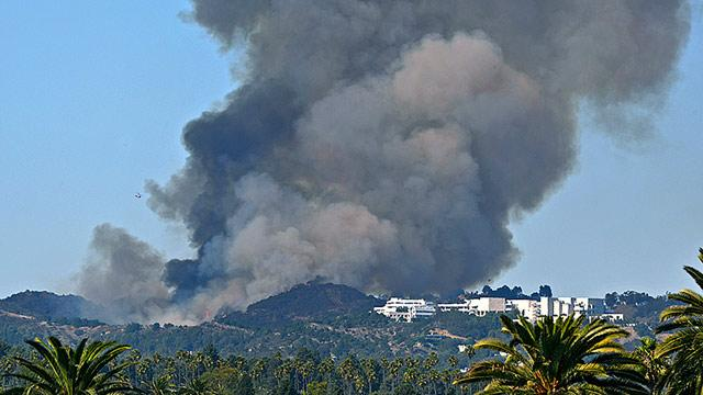 Southern California Firefighters Work to Contain Bel Air Brush Fire