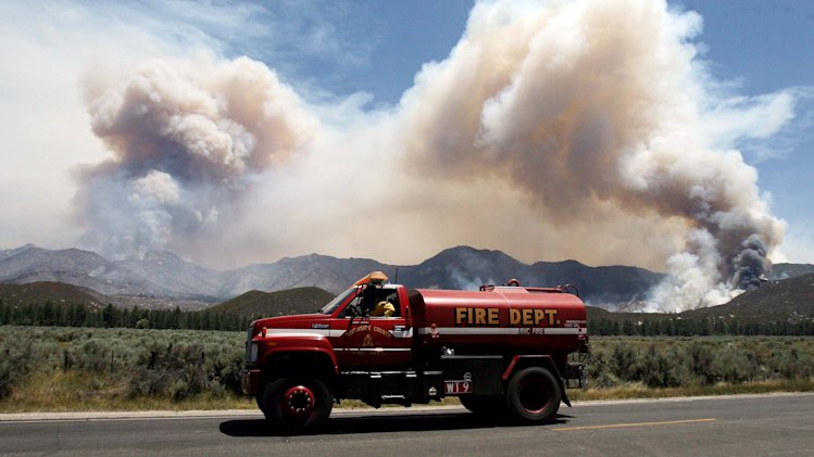 A water tender makes his way back to the the Mountain Fire near Lake Hemet on Tuesday July 16, 2013. The 14,200 acre forest fire near Idyllwild Calif., has caused Idyllwild and adjacent communities east of Highway 243 to issued mandatory evacuations for hundreds of homes Wednesday. (AP Photo/The Press-Enterprise, Frank Bellino)