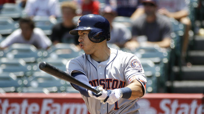 Houston Astros' Carlos Correa hits an RBI single during the first inning of a baseball game against the Los Angeles Angels, Wednesday, June 29, 2016, in Anaheim, Calif. (AP Photo/Jae C. Hong)