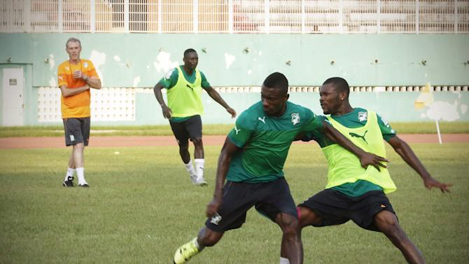 Ivory Coast's national soccers players Salomon Kalou fights for the ball with Serey Die Geoffroy during a training session at the Felix Houphouet-Boigny stadium in Abidjan, Ivory Coast