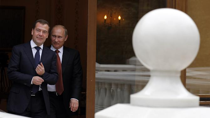 Russian President Vladimir Putin and Russian Prime Minister Dmitry Medvedev, left, at the Novo-Ogaryovo residence outside Moscow, Thursday, Sept. 27, 2012. (AP Photo/RIA-Novosti, Dmitry Astakhov, Government Press Service)