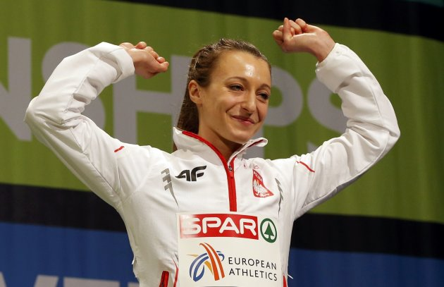 Third placed Broniatowska of Poland celebrates on the podium during the medal ceremony for the women's 1,500m event at the European Athletics Indoor Championships in Gothenburg