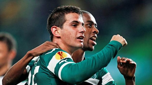 Sporting Lisbon's Valentin Viola celebrates his goal against Videoton with team-mate Gelson Fernandes at Alvalade stadium (Reuters)