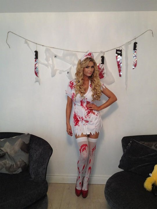 Glamour model Nicola McLean went for a sexy nurse Halloween costume. Copyright [Nicola McLean]